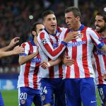 Mandzukic treble helps Atletico into knock-out rounds