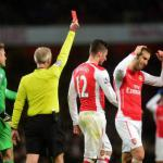 Arsenal win despite Giroud red card