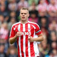 Hughes warns Man Utd off Shawcross