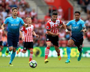 Shane Long leaves newborn son at home as Southampton travel to Prague
