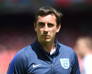 Gary Neville backs Arsenal boss Arsene Wenger and defends 'idiot' remark