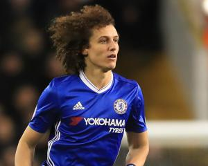 Chelsea defender David Luiz is staying grounded despite widening gap at the top