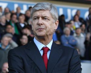 Lauren backs new deal for Arsene Wenger but urges Arsenal to spend this summer
