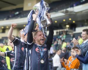 Jim McIntyre puts Ross County's celebrations on hold for a week