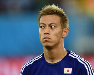 Honda penalty earns win for profligate Japan
