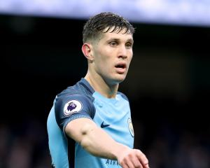 Man City defender Stones buoyed by messages of support from opposing players