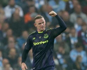 Rooney reaches landmark but Sterling denies Everton