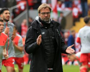 Jurgen Klopp hopes Liverpool players can handle pressure and finish in top four
