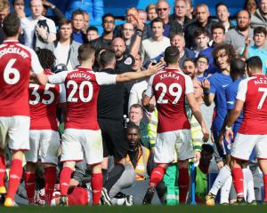 Arsenal battle to deserved point at 10-man Chelsea