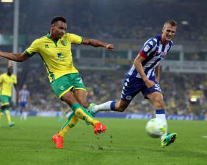 Two-goal Jacob Murphy is match winner for Norwich who survived late Wigan onslaught