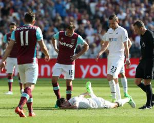 Swansea skipper Jack Cork battling to be fit for Watford showdown