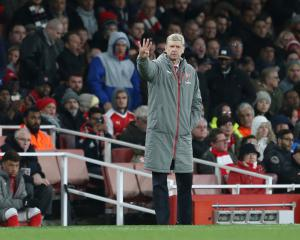 Arsenal had Arsene Wenger worried before stepping up the pace to see off Swansea