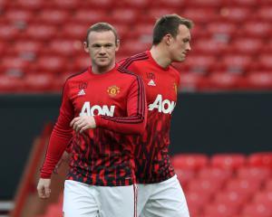 Defender Phil Jones says scrutiny is 'water off a duck's back' for Wayne Rooney