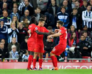 Liverpool turn on the style to beat West Brom