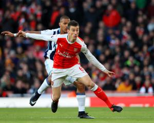 Laurent Koscielny says Arsenal must unite and show fight to stake title claim