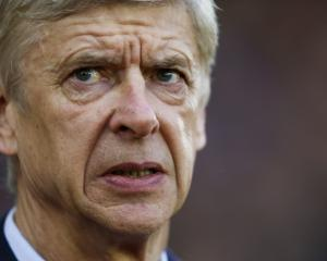 Wenger takes positives from Champions League exit