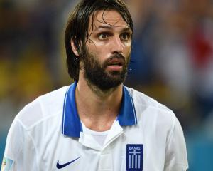 Samaras proud to put Greece through