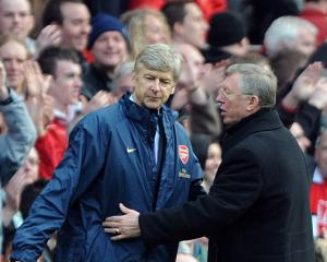 Wenger never tempted to join Man United