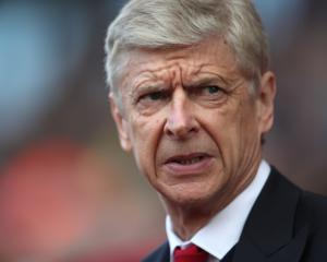 Arsene Wenger not giving up hope of Champions League qualification