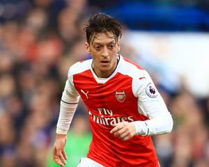 Mesut Ozil expects Arsenal to learn from 'devastating' Champions League exit