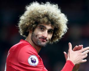 Manchester United's Marouane Fellaini in no rush to pursue China move