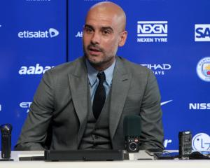 Pep Guardiola keen to shake hands with Manchester rival Jose Mourinho in Beijing