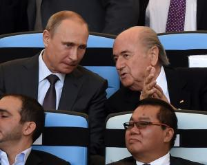 Putin inherits World Cup baton, promises unforgettable 2018
