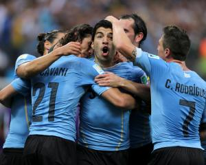 Uruguayans, president included, back Suarez