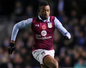 Swansea seal Jordan Ayew swoop as Neil Taylor heads to Aston Villa