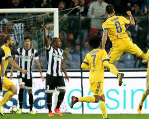 Sami Khedira takes home the match ball as 10-man Juventus hit Udinese for six