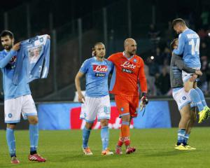Ten-man Napoli win violence-marred Cup final