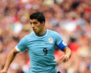 Suarez misses Uruguay opener