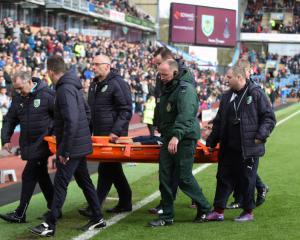 Spurs midfielder Harry Winks taken to hospital after injuring ankle at Burnley