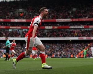 Shkodran Mustafi says Arsene Wenger speculation hard to avoid for Arsenal squad