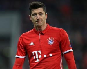 Bayern stroll to victory over rivals Dortmund