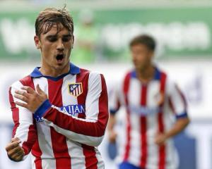 Atletico struggle past Eibar for first win