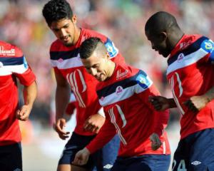 Hazard shines as Lille close on top spot