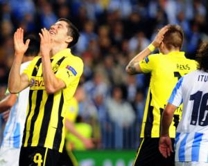 Malaga primed for Dortmund battle