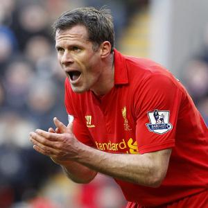 Carragher alarmed at Suarez stance