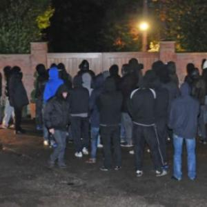 Wayne Rooney under fire: Mob of Manchester United fans gather outside house