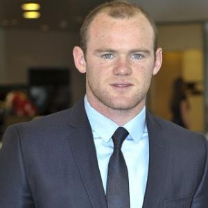 Rooney 'to consider phone hacking action'