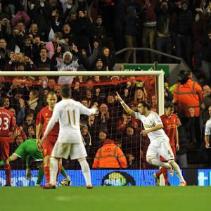 Swansea see off holders Liverpool