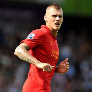 Skrtel commits long term future and pens new Reds deal