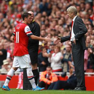 Ozil impressed by Wenger