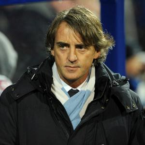 Man City boss Roberto Mancini vows to cut the gap in February