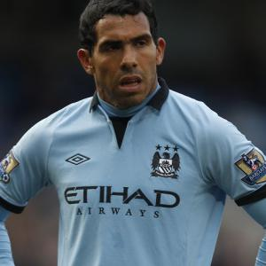 Man City boss Roberto Mancini plays down Carlos Tevez punishment