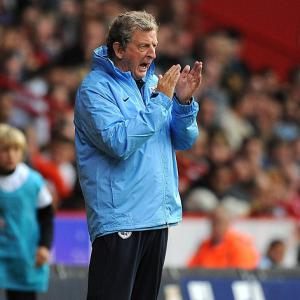 Hodgson backs players after rout