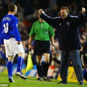 That's my boy! Rooney is welcomed back by old Everton boss Moyes