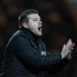 MK Dons snub Blackpool move for manager Karl Robinson
