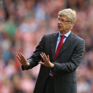 Wenger won't throw money at problems